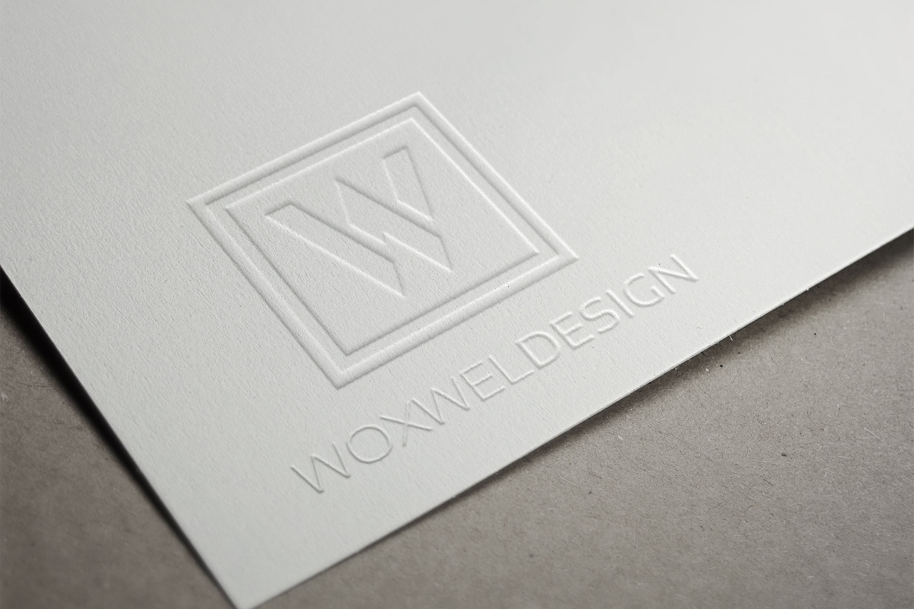 Логотип Woxwel Design - эмбоссирование
